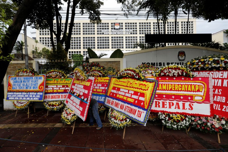 Ten days after Indonesia held the world's biggest single-day elections, more than 270 election staff have died, mostly of fatigue-related illnesses caused by long hours of work counting millions of ballot papers by hand, an official said on Sunday.