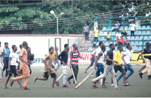 Area boys otherwise know as 'Agbero' storm Agege Township Stadium during the Nigeria Professional Football League Championship (NPFL) between Kano Pillars and Rangers International of Enugu.